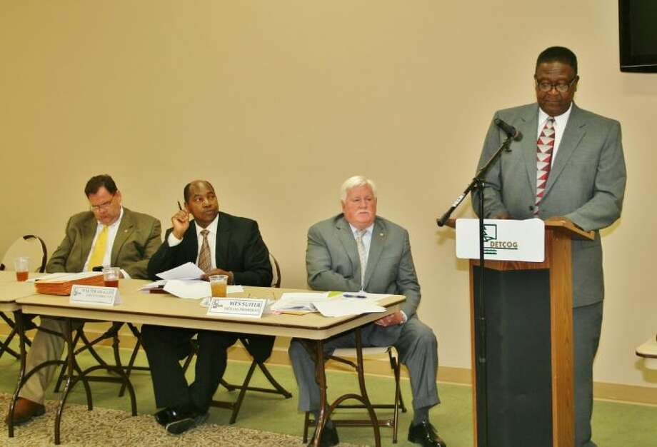 San Augustine Mayor Leroy Hughes, the chair of the Deep East Texas Council of Governments Regional Criminal Justice Advisory Committee, reports on his committee's actions at the April 24 DETCOG board meeting in Center. Also shown (from right) are DETCOG Immediate Past President, Jasper County Judge Mark Allen; DETCOG Executive Director Walter Diggles; and DETCOG President, Angelina County Judge Wes Suiter. Photo: Submitted Photo