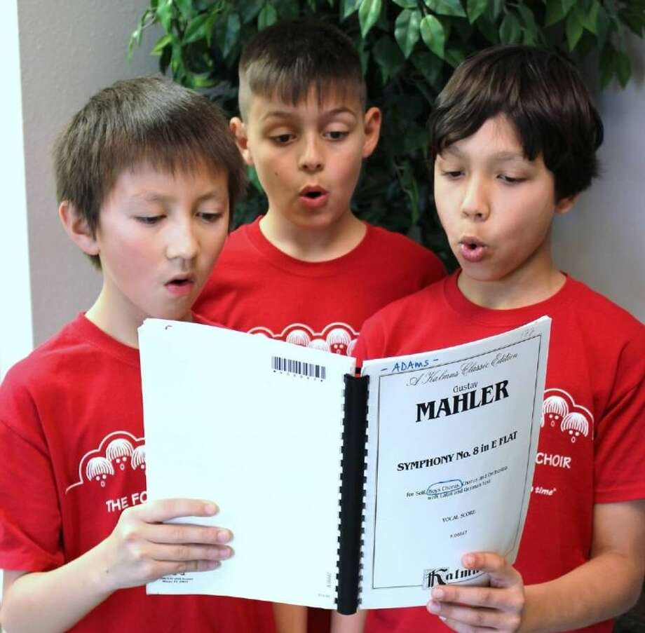 Tour Choirboys Gabe Cote, Reid Curnan and Greyson Abraham practicing a Mahler choral arrangement. Photo: Fort Bend Boys Choir