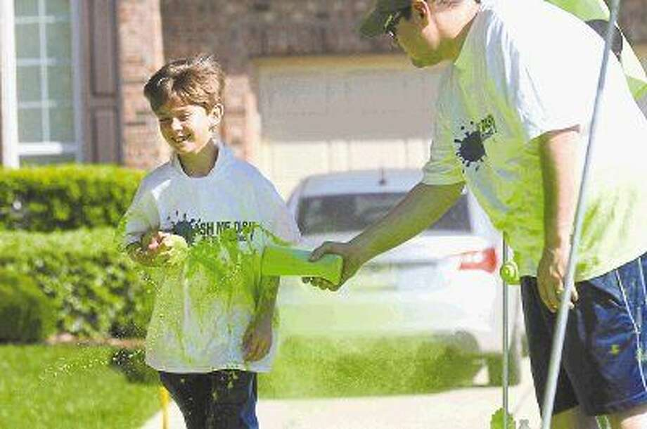 A youngster gets a heavy dose of green powder at last year's Color Run. Photo: Keith MacPherson