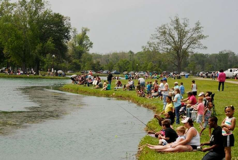 An estimated 220 participants took part in Kid Fish Day at the Liberty Municipal Park on Sunday, April 27, sponsored by B. J. Ford. Photo: CASEY STINNETT / Houston Community Newspapers, 2014