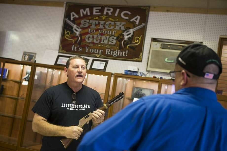 Michael Cantrell speaks with a customer about a Henry Repeating Arms Mare's Leg on April 7, 2015, at East Tex Guns & Ammo in Crosby. Photo: ANDREW BUCKLEY