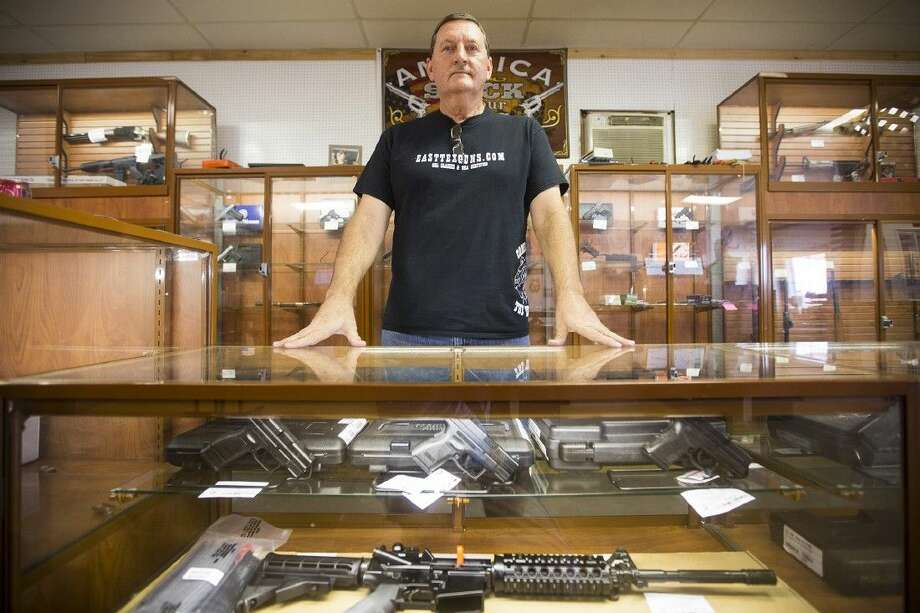 Michael Cantrell poses for a portrait at his shop April 7, 2015, at East Tex Guns & Ammo in Crosby. Cantrell, a former 101st Airborne Division veteran, opened the shop to spread his love of firearms and to teach the community proper firearm safety. Photo: ANDREW BUCKLEY