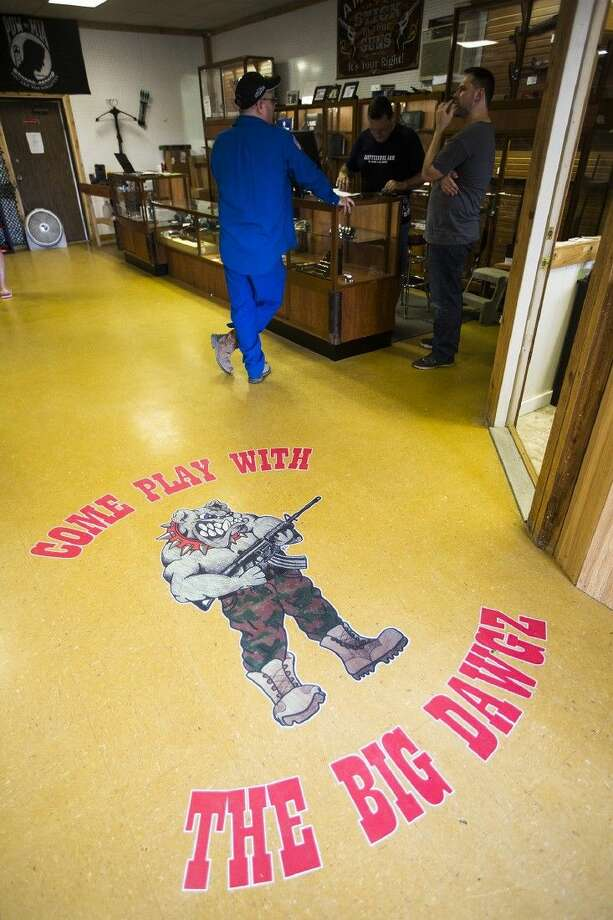The shop's mascot, drawn by Kareena Cantrell, welcomes customers April 7, 2015, at East Tex Guns & Ammo in Crosby. Photo: ANDREW BUCKLEY