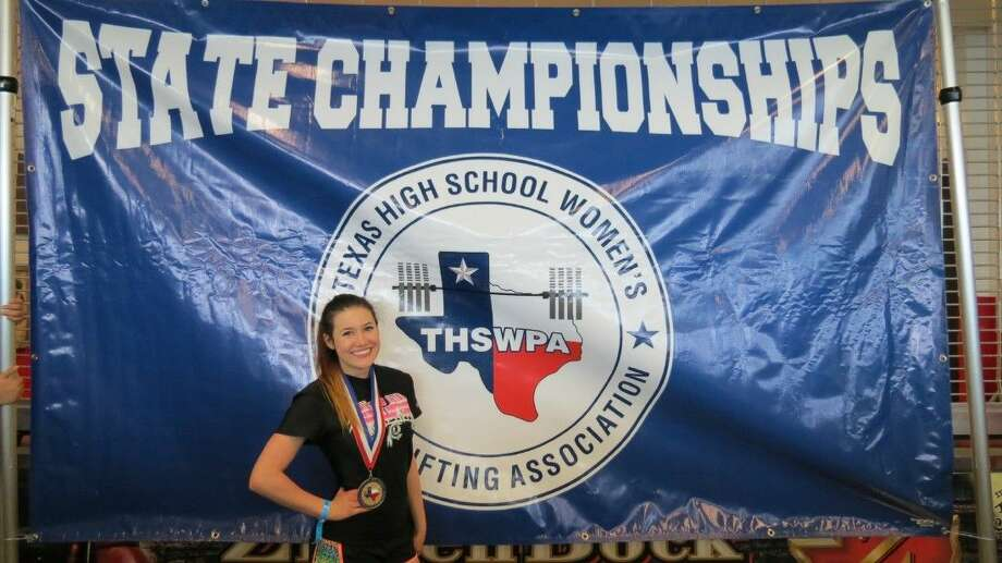 Kyra Rodriguez shows off the gold medal she earned in the 97-pound weight class in the state powerlifting competition on March 20 in Corpus Christi. Photo: Submitted