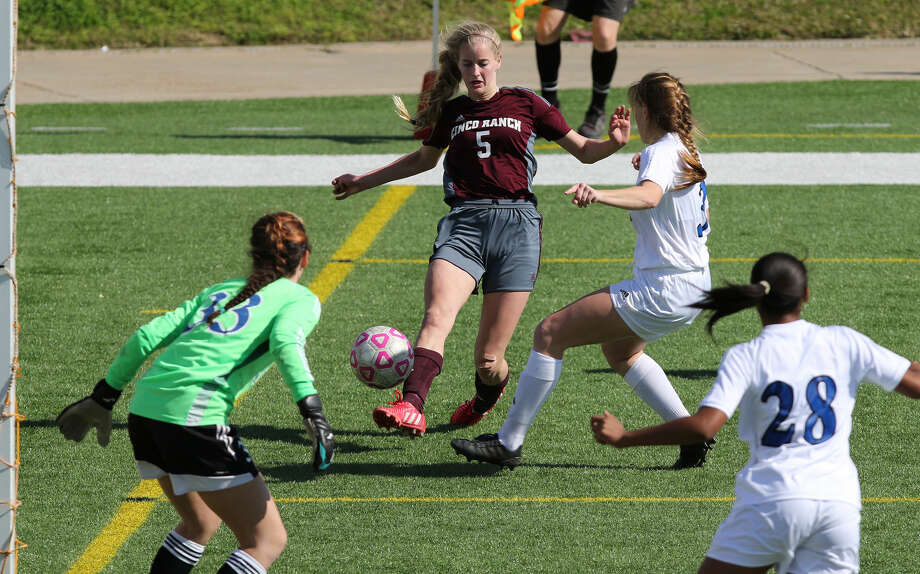 Cinco Ranch's Taryn Siegele, pictured against Clear Springs in the I-10 Shootout, Jan. 17 at Rhodes Stadium, scored the clinching goal as the Lady Cougars defeated Katy 2-0 to reach the regional semifinals. To view or purchase this photo and others like it, go to HCNPics.com. Photo: Staff Photo By Alan Warren