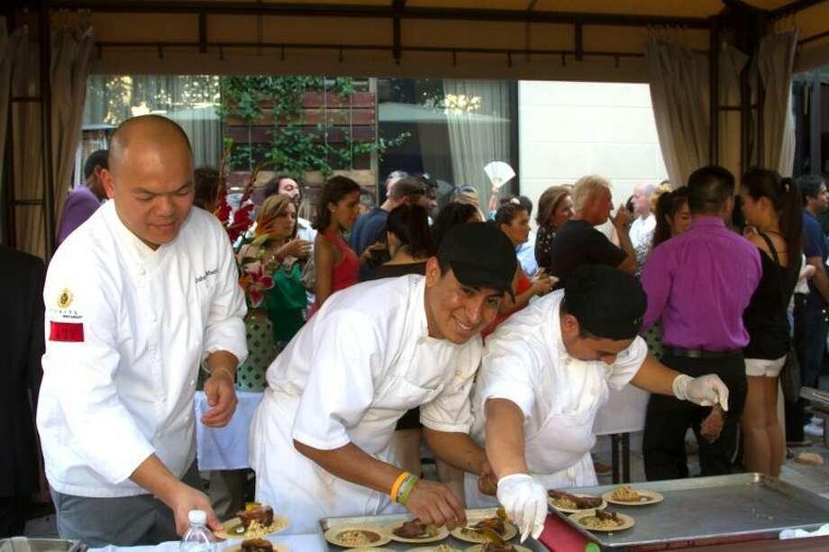 Chef John Sikhattana prepares dishes for the Curry Crawl. Photo: Karen Dressel