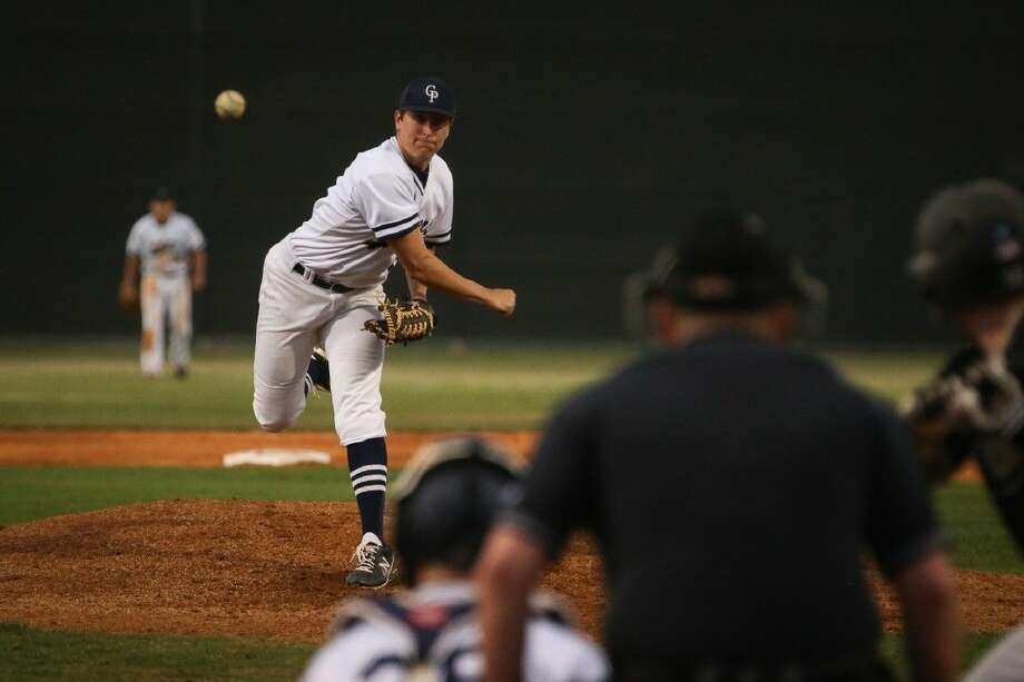 College Park's Beau Ridgeway throws a pitch against Conroe. To view more photos from the game go to HCNPics.com.