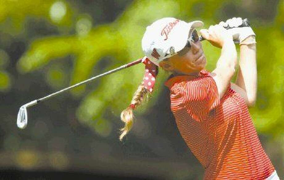 The Woodlands' Greta Bruner hits a tee shot off the 7th tee box during the District 16-6A golf tournament in Montgomery Tuesday. To view or purchase this photo and others like it, visit HCNpics.com.