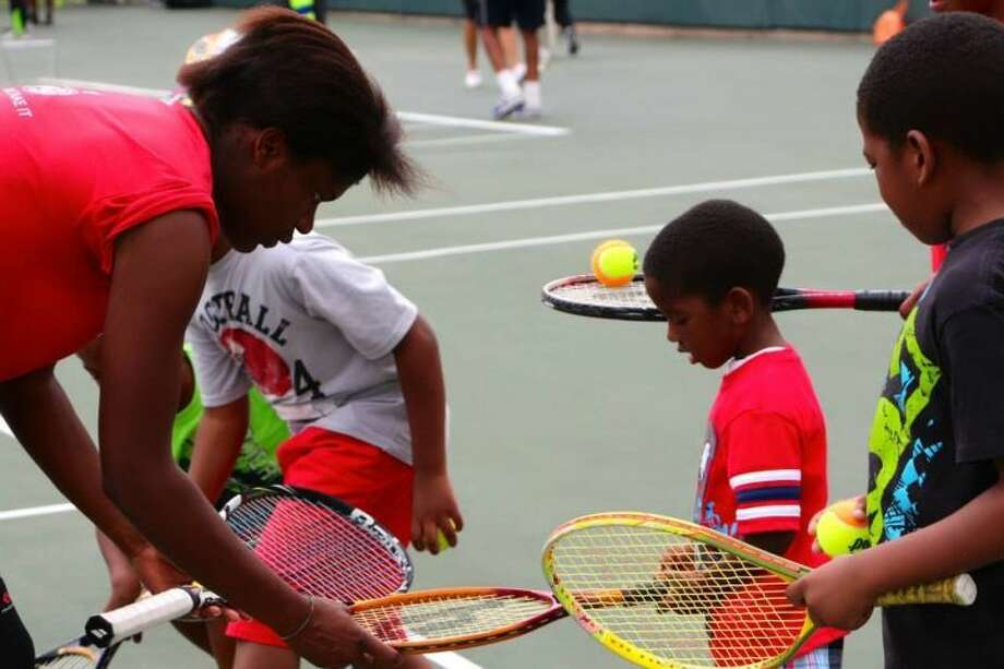 The University of Houston Tennis team took its skills into the community, as the Cougars spent some time with the kids from the Big Brothers and Big Sisters club, Saturday afternoon out at the John E. Hoff Tennis Courts.