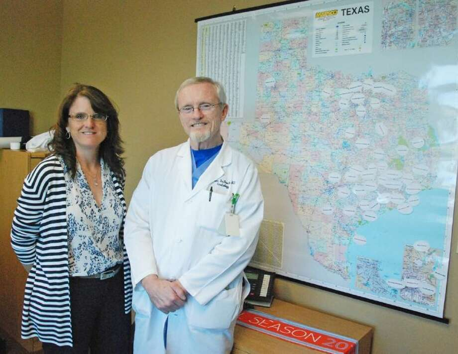 Dr. Tom DeBauche of Cypress Cardiology and his daughter Mary DeBauche, director of operations for the Cypress ECG Project, are helping save students' lives in more than 100 school districts across Texas and as far away as Washington state through their nonprofit organization that provides low-cost electrocardiograms (ECGs) to student athletes. The map pictured in their office pinpoints all the districts that have brought the project into their schools. Photo: Submitted Photo