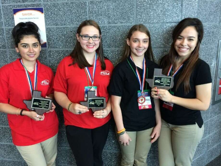 From left, Cypress Ranch students Jessica Cardoso, Kendalyn Butler, Jackie Bily and Daniela Islas display their medals and plaques won at the State FCCLA Leadership Conference, held April 10-12 in Corpus Christi. Photo: Submitted Photo