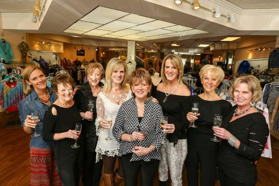 From left to right: Lindsay Vila, Pam Reno, Dalinda Murray, Betty Ann Drury, Betty Griffin, Linda Dietert, Jan Harris, Julie Gee pose for a photograph in the Scruples Boutique on Wednesday, April 16. Scruples will be celebrating its 35th anniversary.