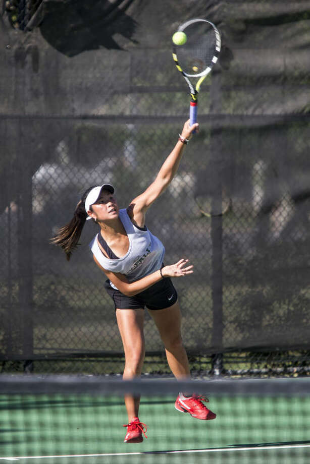 Cypress Falls' Rylee Braeden serves during the UIL State Tennis Tournament on April 28 at Penick-Allison Tennis Center on the campus of the University of Texas at Austin. Photo: ANDREW BUCKLEY