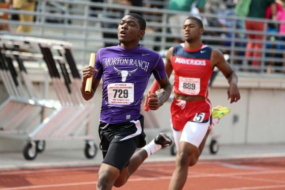 Morton Ranch's Jacarias Martin finishes the Mavericks' regional champion 4x200 relay during the 2014 regional track meet. Martin signed a National Letter of Intent to run track for the University of Houston. Photo: Michael Minasi
