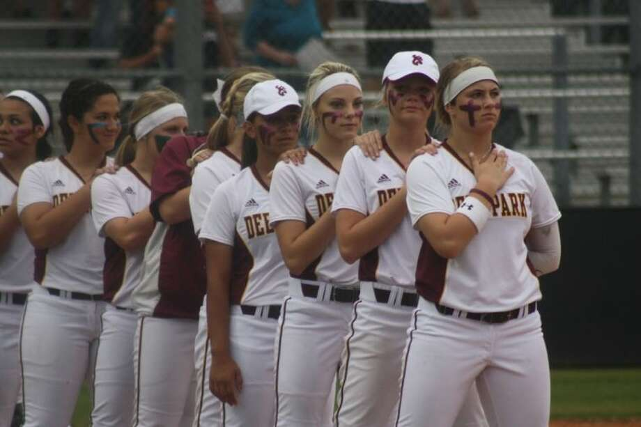 The Deer Park girls softball team stands at attention for the Natonal Anthem prior to a bi-district game. Their season will be on the line again when the team opposes Clear Falls for the Area crown, starting Thursday night. Photo: Robert Avery