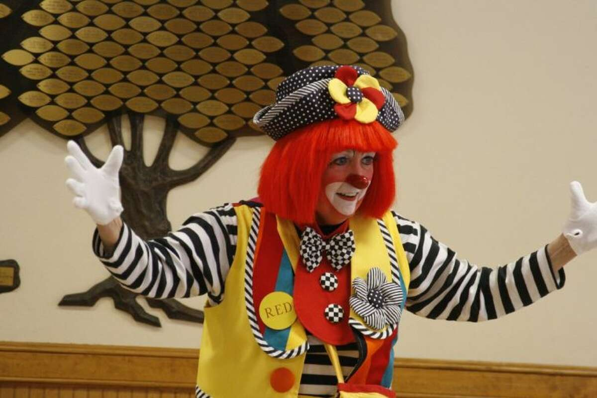 It was a day of the usual carnival games and a visit from a clown for several senior adults at the monthly The Gathering Place held at Humble's First United Methodist Church.