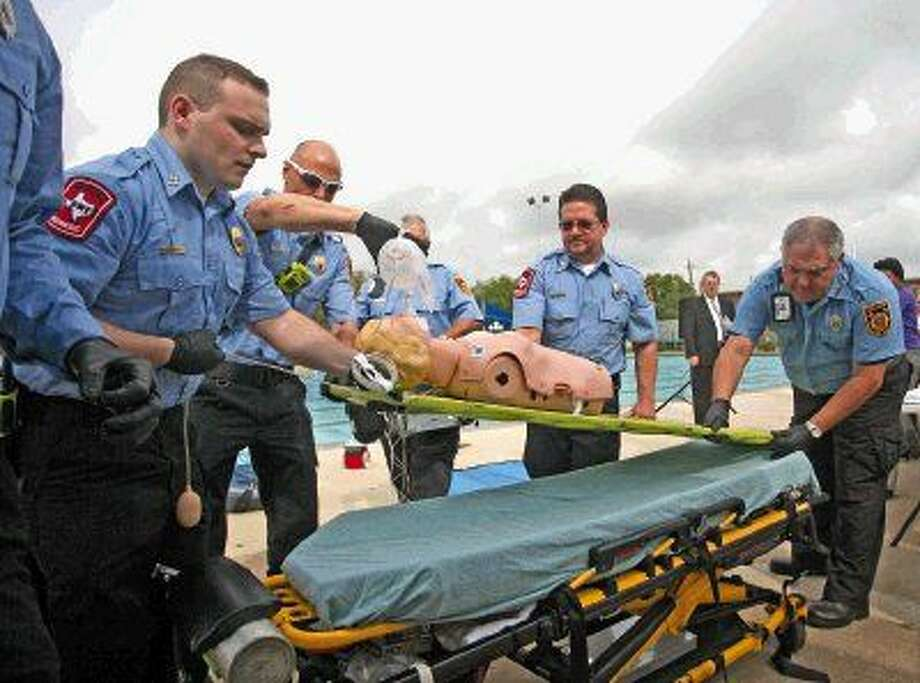 (Right) The Deer Park Fire Department demonstrates a drowning victim in cardiac arrest during the water awareness kickoff event. Photo: Kar B Hlava