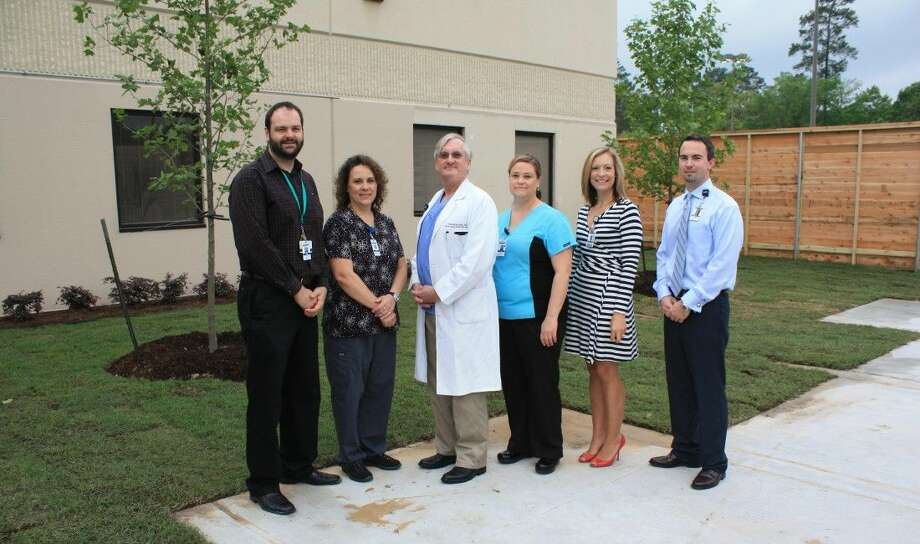 Nursing Rehabilitation Manager Eric Anderson, Occupational Therapist Dena Cooper, Neurologist Wendell Grogan, M.D., Physical Therapy Supervisor Sarah Weigel, Clinical Liaison Crystal Reiser and Inpatient Rehabilitation Director David Fischer in the new courtyard designed for the Inpatient Rehabilitation Unit.