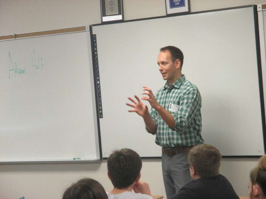 Friendswood alumni and author of two books, Adam Holt spoke recently to seventh grade students at Friendswood Junior High Pre-AP English/Language Arts classes.