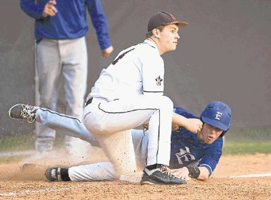 An Episcopal runner and a St. John's infielder both wait for the call during the teams' recent contest at St. John's School. Episcopal, which is the four-time SPC baseball champion, along with St. John's will both begin play Friday in the SPC Division I tournament after both won two games Friday and Saturday to clinch teir spots in the tournament, which begins Friday morning at St. Mark's School and the Episcopal School of Dallas up in the Metroplex. Photo: Kevin B Long / © Copyright 2012, Gulf Coast Shots, All rights reserved.