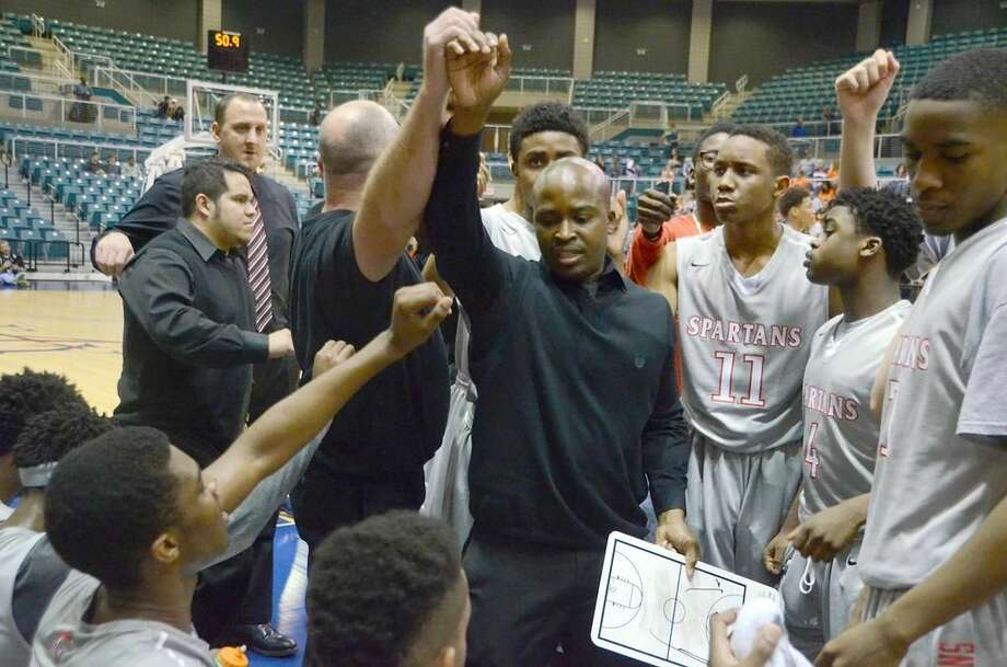 Emmanuel Olatunbosun (middle) stands in the huddle during Cy Lakes' playoff game againstSeven Lakes this season. Hewas promoted as the new boys' basketball head coach at Cy Lakes this week. Photo: Joel Weckerly/CFISD