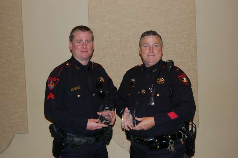 Lt. Stan Jolly and Cpl. Matt Hales with Precinct 4 Constable Ron Hickman's Office receive a special recognition award from Mothers Against Drunk Driving.
