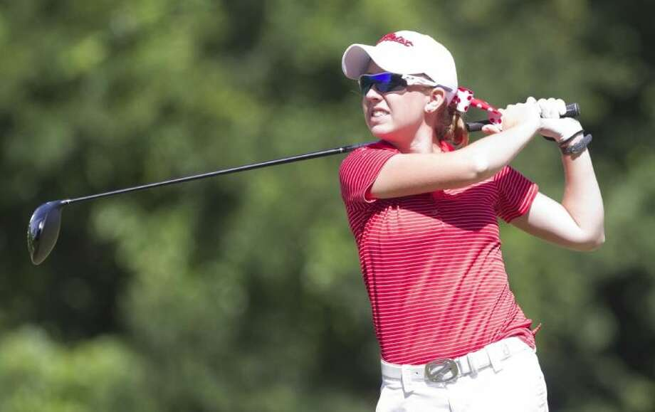 The Woodlands' Carley Charbonneau follows a shot during the second day of the Class 5A state golf tournament on Tuesday at Onion Creek Golf Club in Austin. To view or purchase this photo and others like it, visit HCNpics.com.