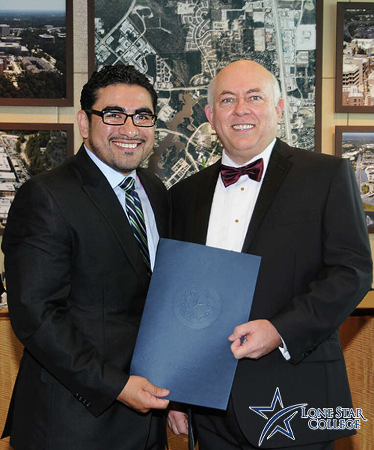 Texas Rep. Armando Walle, left, presents Dr. Richard Carpenter, Lone Star College System chancellor, with a resolution recognizing his many contributions to education. Dr. Carpenter was recognized as part of StarGala 2014, held April 26 at The Woodlands Waterway Marriott.