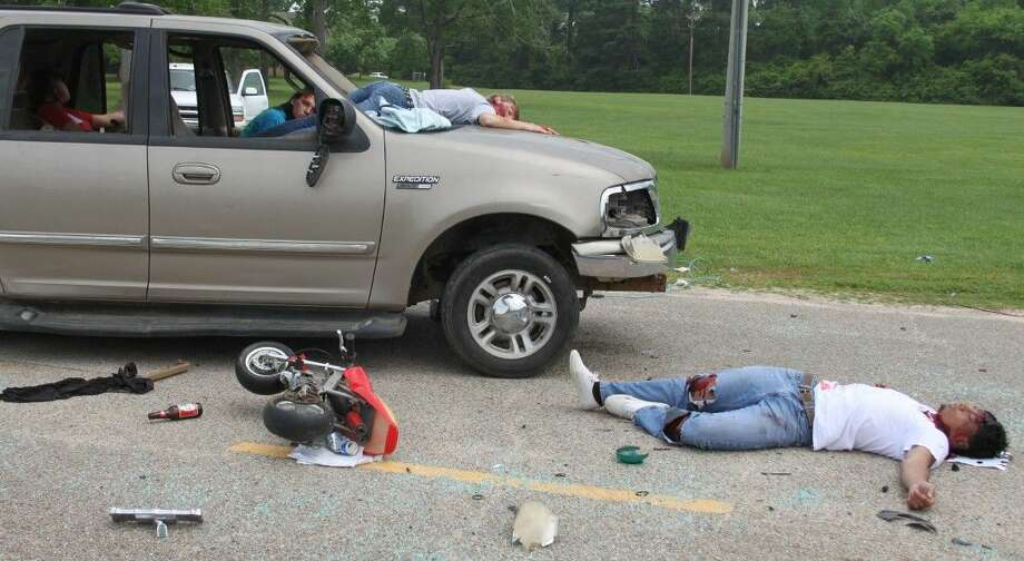 A grisly wreck is presented to the students of Coldspring-Oakhurst High School with the victims either dead or awaiting rescue inside of their vehicles. Photo: Jacob McAdams