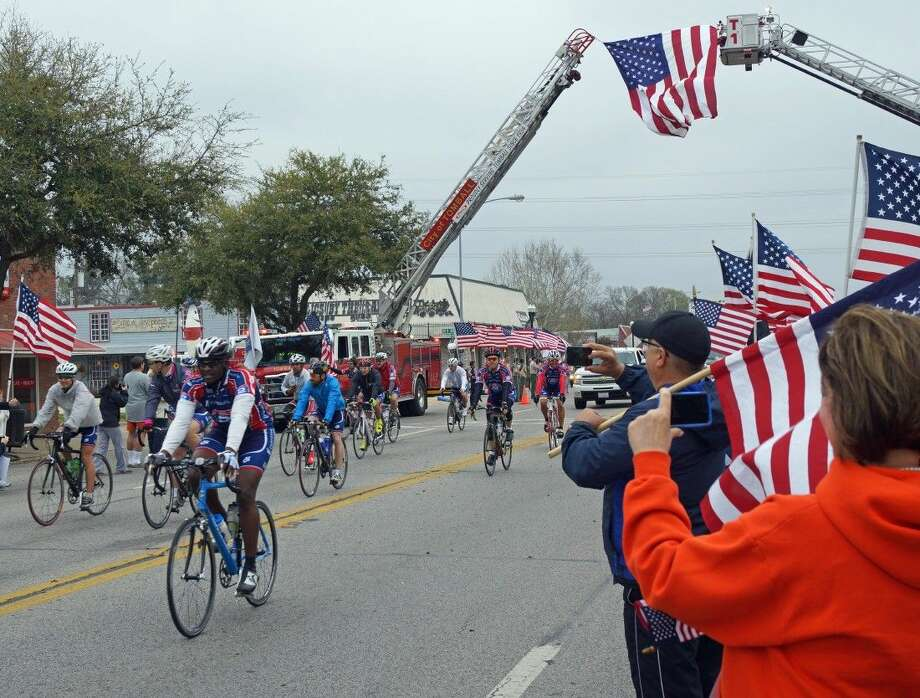 "Ride 2 Recovery returns to Tomball on Sunday, April 19, as more than 200 wounded warriors and active duty military cycle their way to Fort Worth. Hundreds of Tomball residents lined Main Street as the R2R ""Texas Challenge"" stopped in Tomball in 2014. Photo: Submitted"