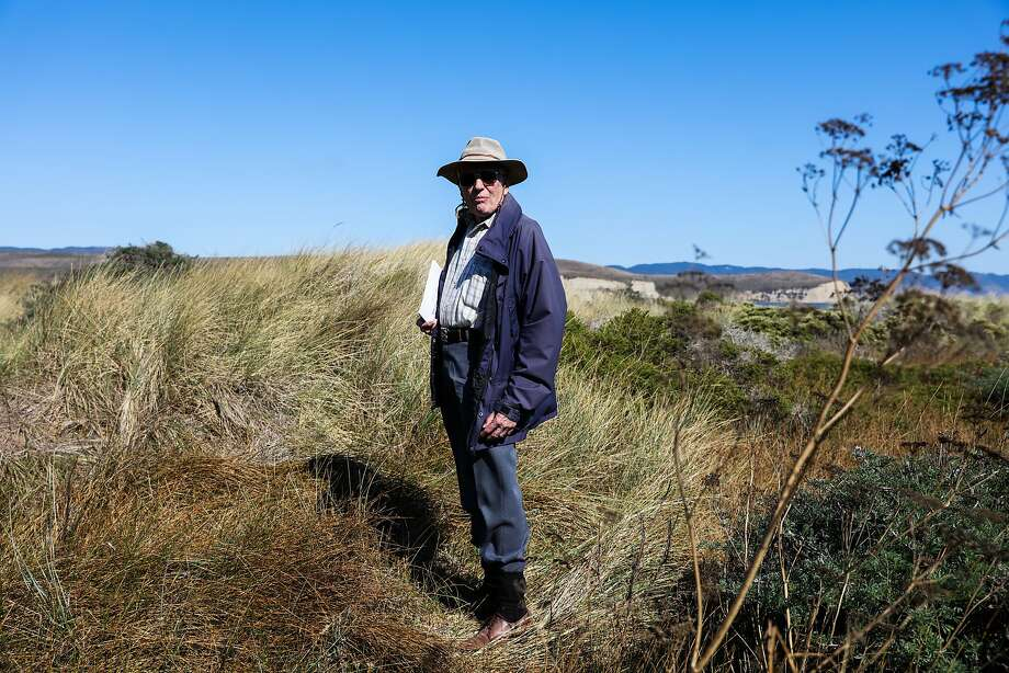 Historian and President of the Drake Navigators Guild, Edward Von Der Porten, died Sunday, April 8, 2018, at stands in tall grass at age 84. Here he is on Sept 27, 2016, at Drake's Cove while giving a tour of the area, in Inverness, Calif. Photo: Gabrielle Lurie / The Chronicle