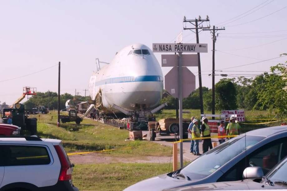 The 747 Shuttle Carrier sits on a side road adjacent to Texas State Highway 3 as it waits to make the final move up NASA Parkway to Space Center Houston Tuesday night, April 29. Photo: KIRK SIDES