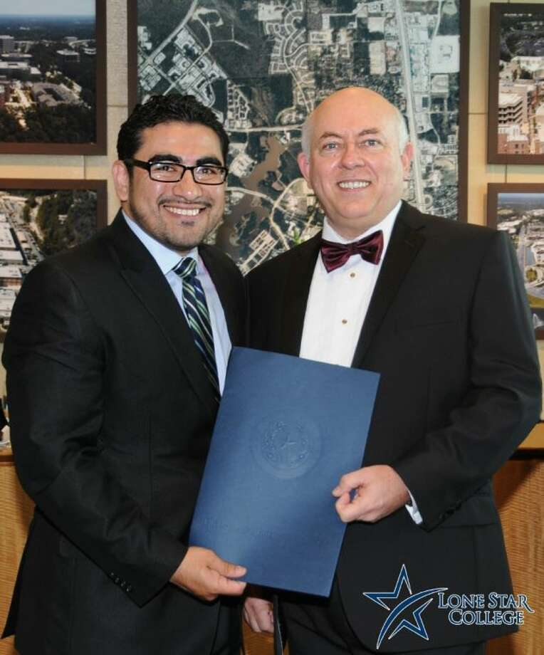 Texas Rep. Armando Walle, left, presents Dr. Richard Carpenter, Lone Star College System chancellor, with a resolution recognizing his many contributions to education. Dr. Carpenter was recognized as part of StarGala 2014, held April 26 at The Woodlands Waterway Marriott. Photo: Submitted