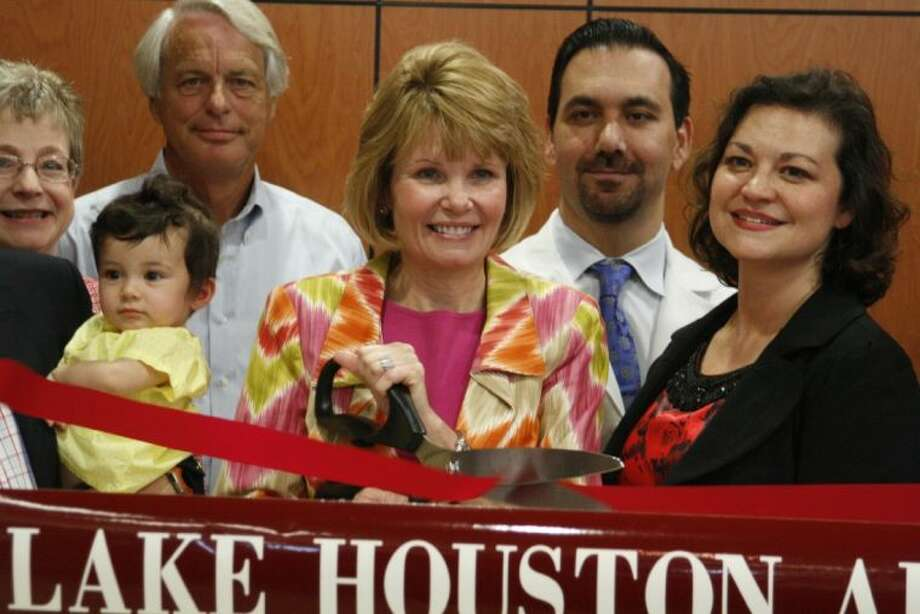 Kingwood Medical Center's Chief Executive Officer Melinda Stephenson cuts the ribbon at the grand opening of The Women & Children's Center at Kingwood Medical Center Tuesday, April 29, 2014.