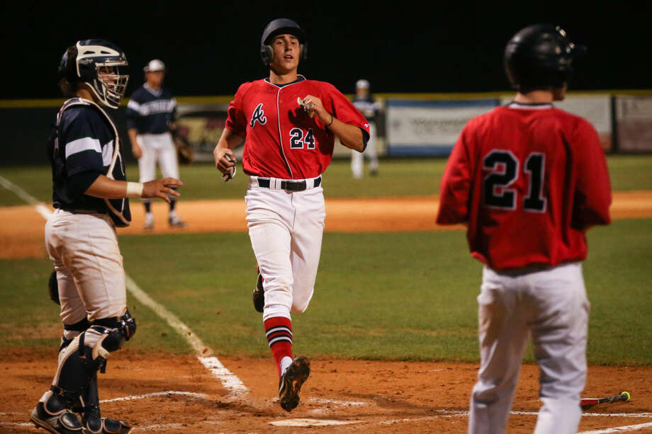 Atascocita's Matt Willrodt (24) tags home after being batted in during the high school baseball game against College Park on Friday, April 10, 2015, at College Park High School. To view more photos from the game, go to HCNPics.com.