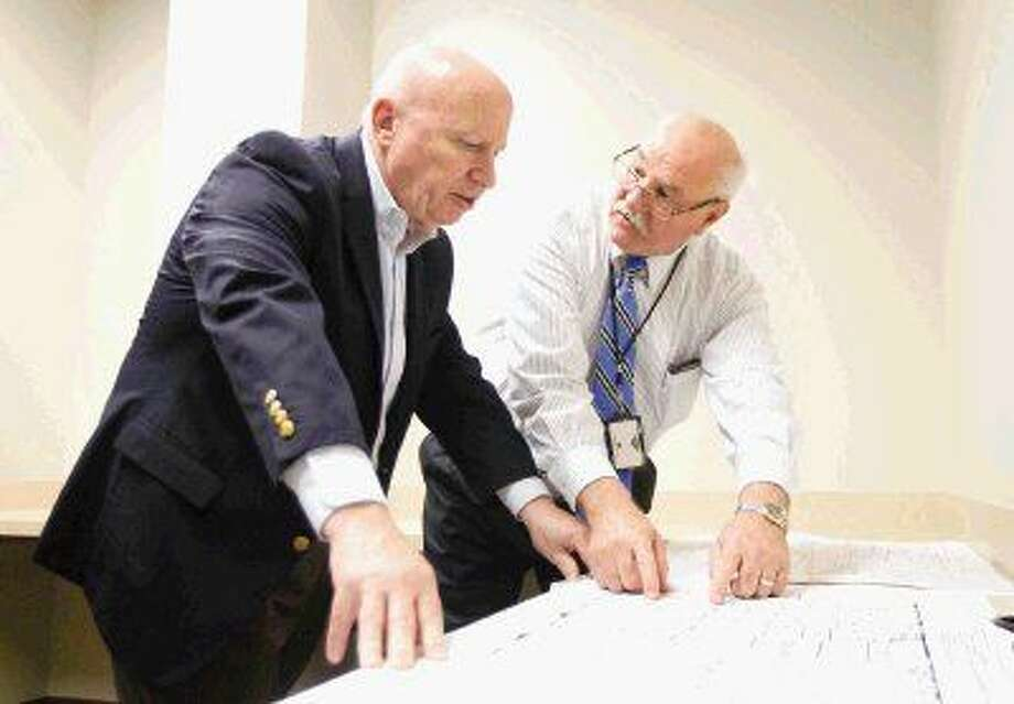 U.S. Rep. Kevin Brady, R-The Woodlands, goes over a blueprint of the Conroe Veterans Affairs' new 30,000-square-foot clinic with Lawrence Steward, health systems specialist for the VA's DeBakey Medical Center in Houston, Friday. The new facility is three times the size of the VA's current building on Riverwood Court.