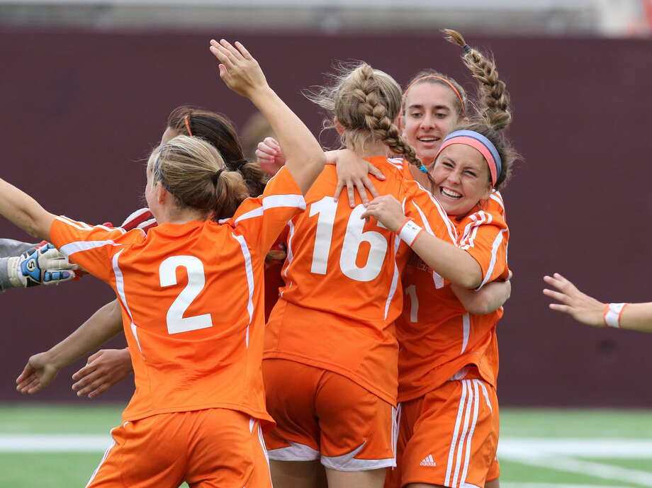 Seven Lakes celebrates Morgan Profitt's winning goal in a shoot out to defeat Fort Bend Austin 5-4 during Region 3 Soccer Tournament, April 10 at Abshier Stadium in Deer Park. To view or purchase this photo and others like it, go to HCNPics.com. Photo: Staff Photo By Alan Warren