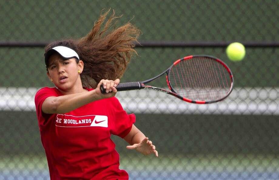 The Woodlands' Debra Gonzalez returns a serve during the District 16-6A girls double tennis finals Thursday.