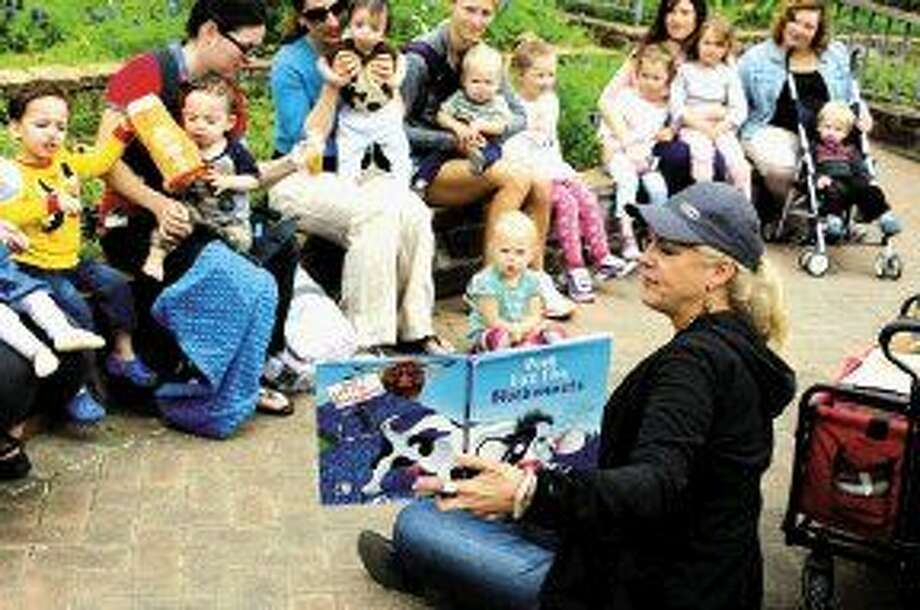 Children heard bluebonnet-themed stories among the bluebonnets during story time at Mercer Botanic Gardens in Precinct 4.