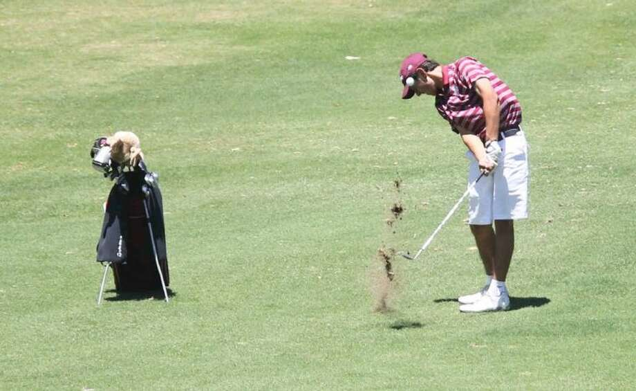 A Deer Park golfer hits more than just his ball on this fairway shot at Onion Creek Golf Course Monday. Photo: Jason Fochtman