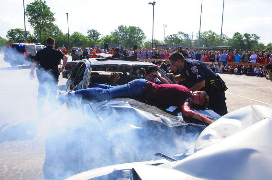 Students at Concordia Lutheran High School particpate in a re-enactment of a fatality DWI accident simulating their own death during the Shattered Lives of Tomball program on Tuesday, April 7, 2015.