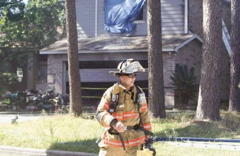 The South Montgomery County Fire Department and the Montgomery County Fire Marshal's Office are investigating a fire that was intentionally set inside an Imperial Oaks home Wednesday afternoon. Investigators said another fire previously had been set at the home less than 24 hours before, and investigators are treating the incident as an arson case. Photo: Jason Fochtman / Conroe Courier / HCN