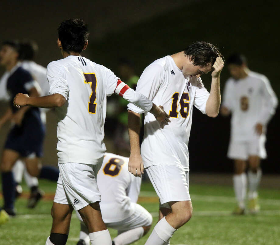 Deer Park's Derek Alexander (16) is in disbelief after missing a penalty kick late in the game that would have tied the match against Aldine Friday night. Photo: Kar B Hlava