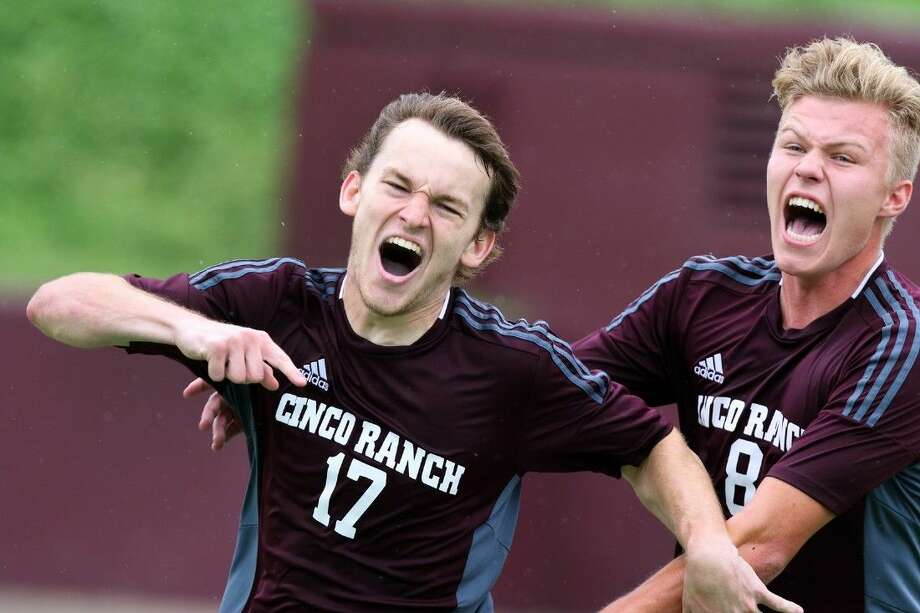 Cinco Ranch's Scott Thomson and Aarstein Halderaker celebrate a score on a penalty kick by Thomson against Aldine during the Region 3 Soccer Tournament Final, April 11 at Abshier Stadium in Deer Park. To view or purchase this photo and others like it, go to HCNPics.com.
