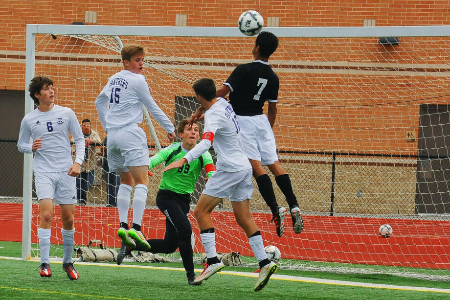 Ridge Point's Ben Garza (6), Brandon Jones (15), Jamie Flynn (16) and Jacob Griffin (99) defend the net against Spring Woods during the Region III-5A semifinals April 10 at Turner Stadium in Humble. The Panthers lost 3-0 but recorded an undefeated regular season and reached their first regional tournament Photo: Tony Gaines