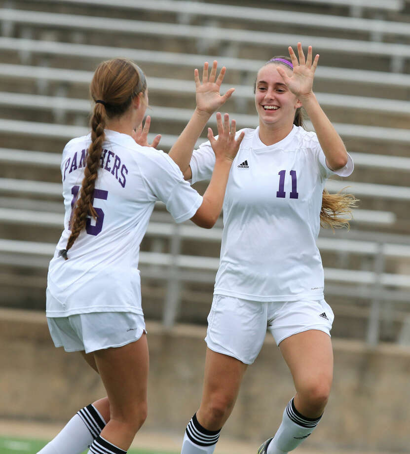 Ridge Point's Courtney Pawlik celebrates her goal with Alex Thompson against Lamar Consolidated during Bi-District Playoffs, March 26 at Mercer Stadium in Sugar Land. The Lady Panthers defeated Magnolia 5-0 to advance to the Region III-5A championship. To view or purchase this photo and others like it, go to HCNPics.com.