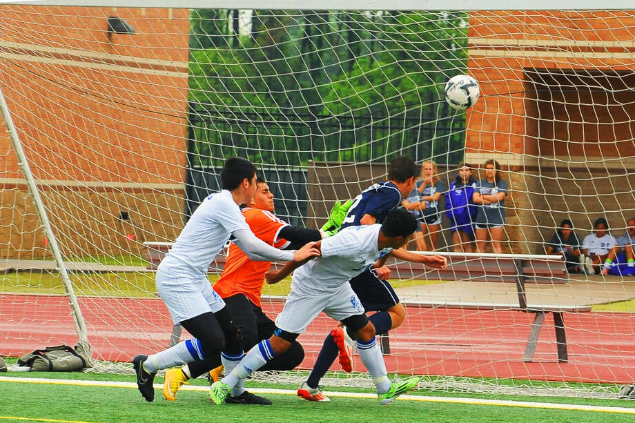 Matthew Sim (in navy) scored the lone goal against C.E.. King, sending Tomball Memorial to the class 5A region III finals Photo: Staff Photo By Tony Gaines