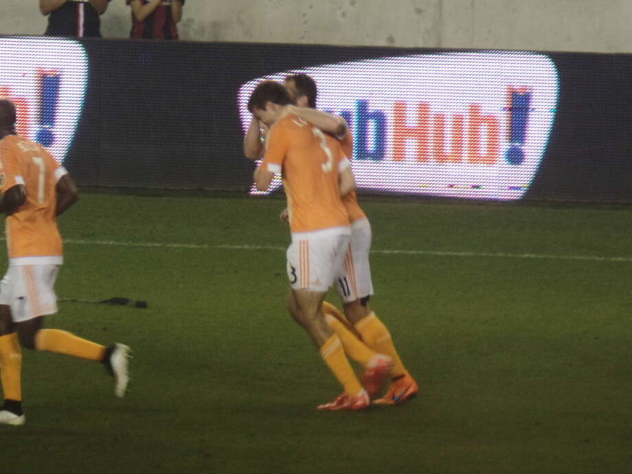 Houston Dynamo captain Brad Davis celebrates with rookie Rob Lovejoy (No.3) after scoring his first professional goal. Photo: Staff Photo By Cameron Brock