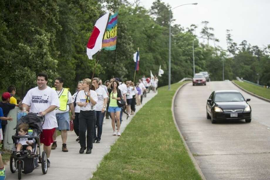 Walkers march down West Lake Houston during last year's March of Remembrance.