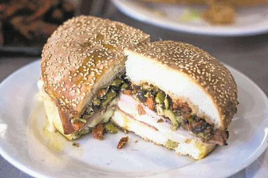 The muffalotta, a baked sandwich with Italian meats, cheeses and an olive spread, has twice as many sales per week at Ragin Cajun in The Woodlands than any other location in the company. Photo: Staff Photo By James Ramos / @WireImgId=2673418